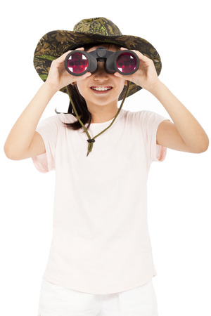 smiling asian Little girl looking through binoculars. isolated on white background photo