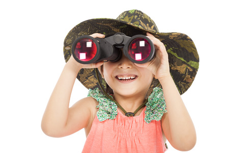 smiling asian Little girl looking through binoculars. isolated on white background