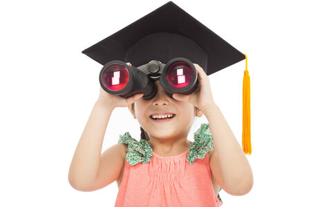 Little girl student looking through binoculars. isolated on white background photo