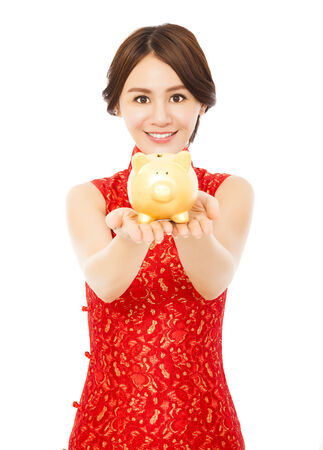 smiling woman holding a golden piggy bank . happy chinese new year.financial concept photo