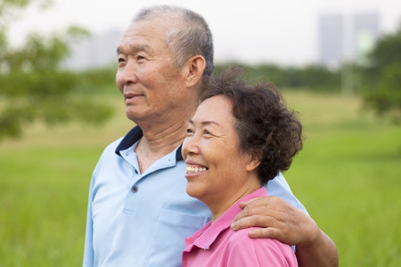 Happy elderly seniors couple in the park. retirement and health concept photo