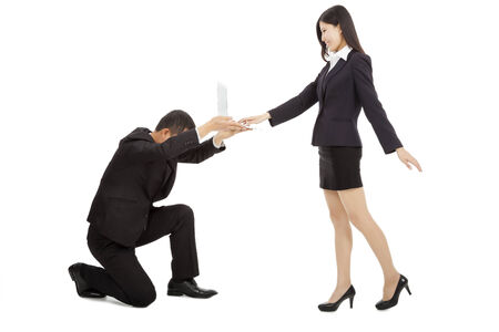 buisness man holding a laptop for female manager using.Business power concept photo