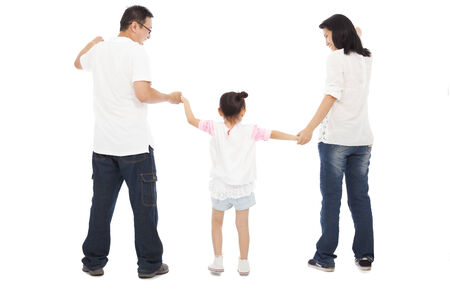 happy little girl hold parents hands. isolated on white background photo