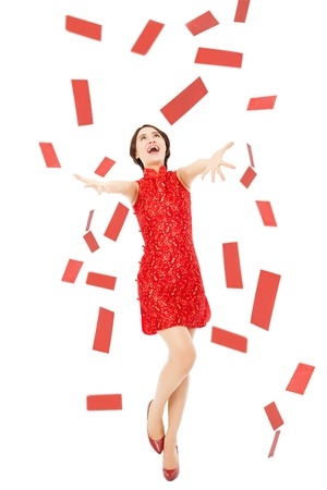 happy chinese new year.young woman trying to catch red envelope for good luck and rich Stock Photo
