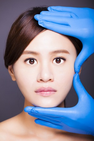 asian model: young attractive asian woman face