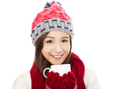 warm drink: beautiful woman wearing winter clothing and holding coffee cup