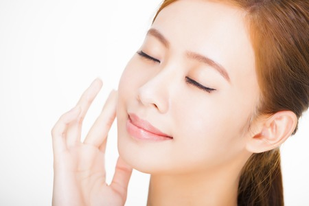 Beautiful face of young adult woman with clean fresh skin. skin care concept photo