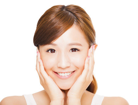 Close up of asian young womans face with smile expression. happiness concept Stock Photo