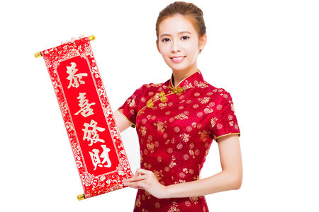 beautiful asian woman holding a congratulation reel. happy chinese new year concept photo