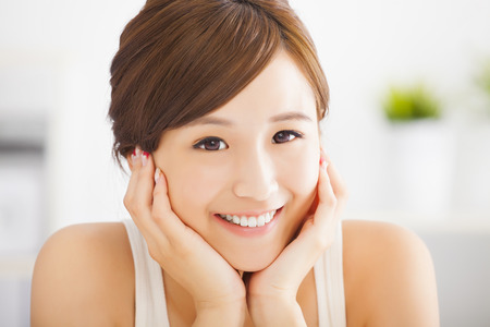 sweet smile: beautiful and smiling  asian young woman