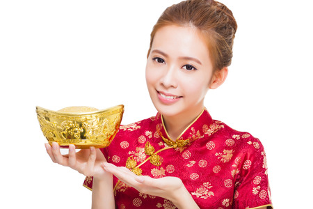 happy asian woman showing  gold for chinese new year photo