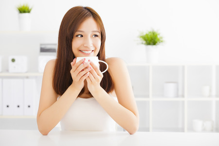 morning coffee: happy asian young drinking coffee Stock Photo