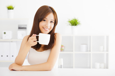 happy asian young drinking coffee 写真素材