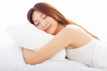beautiful young  woman sleeping in the bed photo