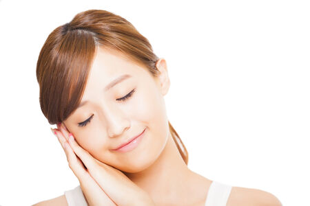 clear skin: smiling  young asian woman face Stock Photo