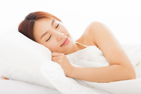 girl lying bed: beautiful young  asian woman sleeping in the bed Stock Photo
