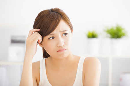 closeup confuse young asian woman Stock Photo