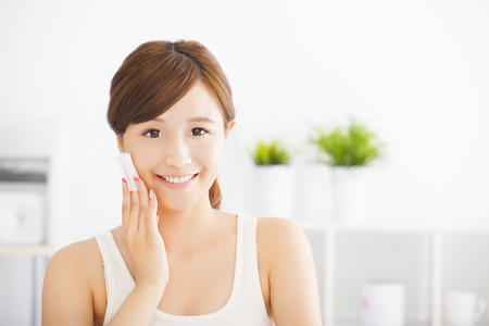 woman face cream: Beautiful asian young woman cleaning her face with cotton