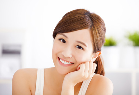 woman beauty: smiling young asian woman face