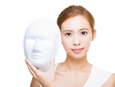 beautiful woman holding white mask for skincare concept