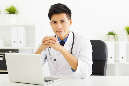 asian medical: young doctor working with laptop in office