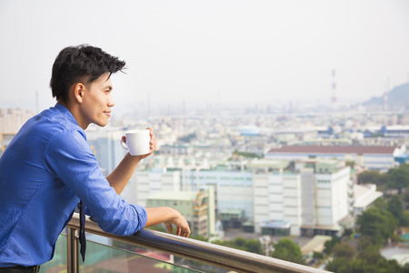 relaxed businessman watching the city view