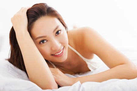 asian sexy girl: young Beautiful asian woman relaxing on the bed