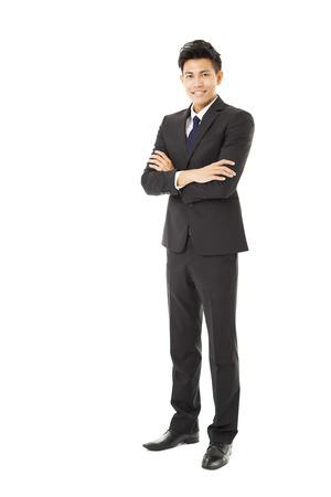 ufficio aziendale: lunghezza totale giovane uomo d'affari in piedi