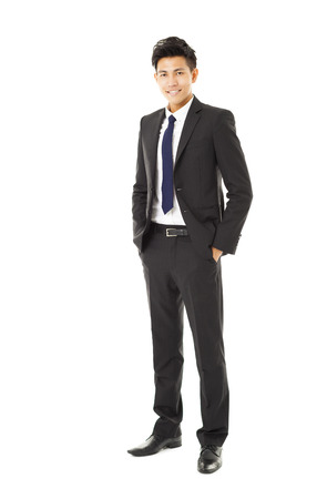 full suit: full length young smiling businessman standing