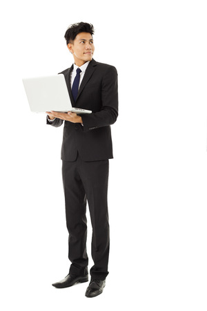 young smiling business man holding laptop