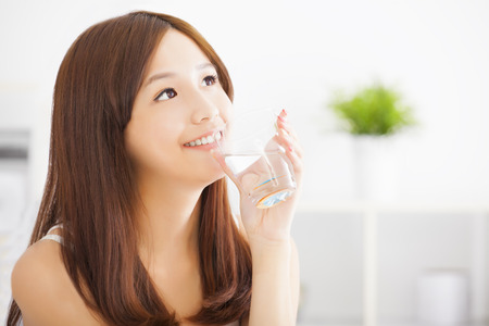 drink: Young attractive woman drinking clean water