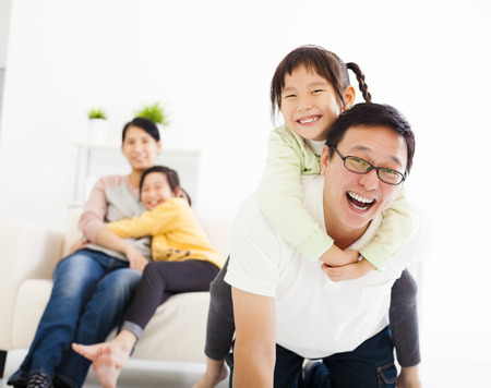 happy asian family in the living room Standard-Bild