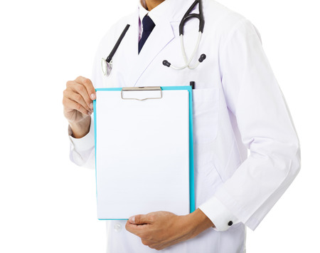 dentist concept: young doctor showing empty clipboard Stock Photo