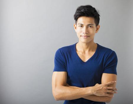 asian bodybuilder: smiling muscular asian young man Stock Photo