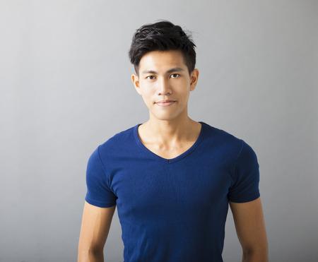 smiling muscular asian young man 版權商用圖片