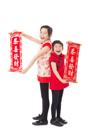 cheongsam: asian little girls showing couplets for happy chinese new year