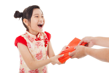 red envelope: happy asian little girl received red envelope for  chinese new year