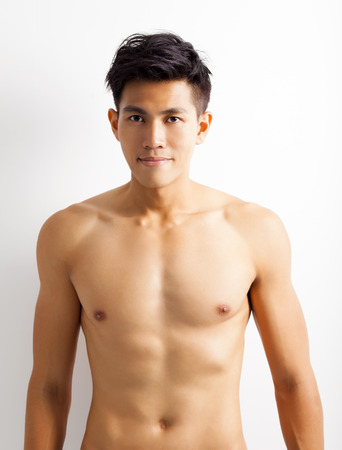 human chest: smiling shirtless muscular young asian man Stock Photo