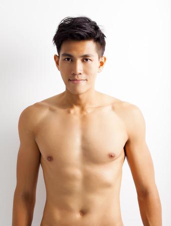 torsos: smiling shirtless muscular young asian man Stock Photo