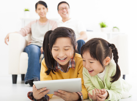 happy little girls using tablet computer 스톡 콘텐츠