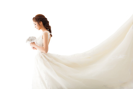 white dresses: Young attractive bride with flowers