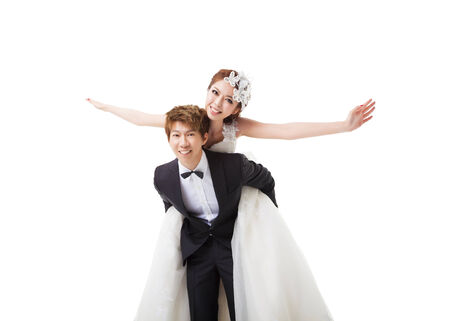 happy couple white background: beautiful asian bride and groom