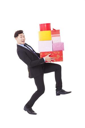 dar un regalo: feliz gente de negocios con caja de regalo Foto de archivo