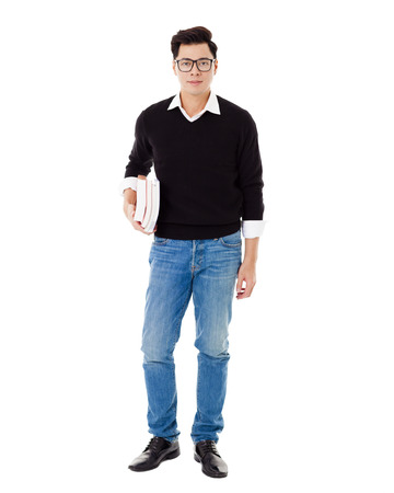 young man jeans: Full length portrait of  smiling school boy holding books Stock Photo