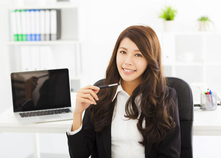 girl laptop: happy young business woman working in the office Stock Photo