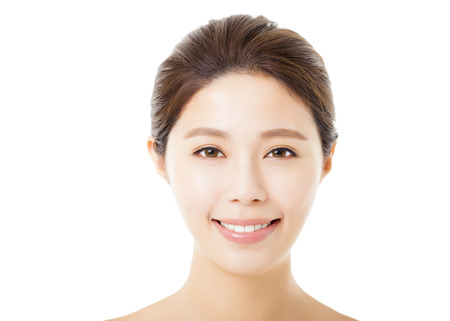 and in asia: closeup beautiful young  woman face isolated on white