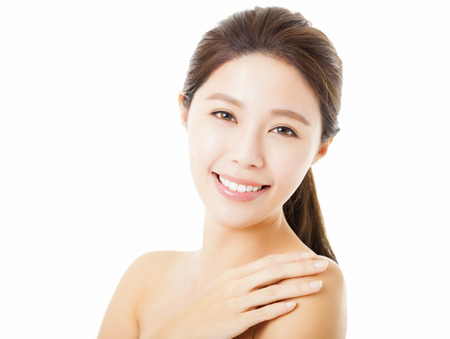 asian girl face: smiling beautiful young  woman face isolated on white