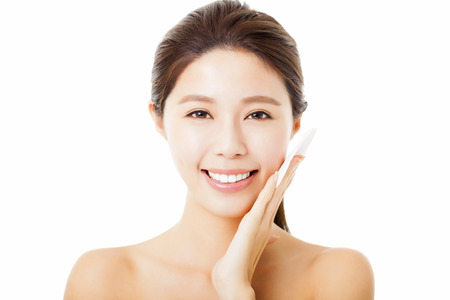 cotton swab: Beautiful  young woman cleaning her face with cotton