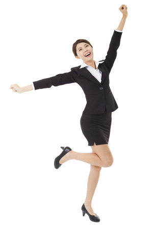 happy young businesswoman jumping and dancing
