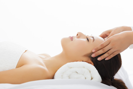 Young  woman getting spa treatment over white background Banque d'images